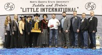 Mitch Molitor, a senior in agricultural economics from Watkins, Minn., was named the overall showman at the 95th Little International at North Dakota State University Feb. 13. Pictured L to R: Maddie Patterson and Annabelle Hardwick, Little I Princesses; Samantha Pernsteiner, Little I Queen; Ashlyn Dilley, Little I Assistant Manager; Kadey Holm, Little I Manager; Julie Ellingson, Little I Agriculturist of the Year; Molitor; Cole Rupprecht, Dairy judge; Ben Hawkins, Cattle judge; Jeremy Lehrman, Swine judge; and Isaiah Bauck, Sheep judge. (NDSU photo)