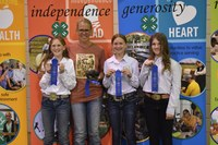 The McLean County team takes first place in the junior division of the state hippology contest. Pictured are, from left: team member Bella Wimer, coach Kathy Bear and team members Molly Jochim and Hannah Woodruff. (NDSU photo)