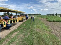 NDSU plant pathologist Michael Wunsch speaks to visitors about plant pathology projects during the Carrington Research Extension Center's 2019 field day. (NDSU photo)