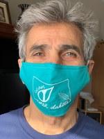 State climatologist Adnan Akyuz models a designer mask designed by Tanya Akyuz that will go to 10 North Dakotans who sign up to be weather observers. (Photo courtesy of Tanya Akyuz)