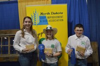This team takes first place in the senior division of the North Dakota state 4-H crop judging contest in Valley City. Pictured are team members (from left) Laura Muggli, Olivia Throener and Wyatt Kessel. (NDSU photo)