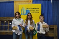 This team placed first in the junior division of the North Dakota state 4-H crop judging contest in Valley City. Team members are (from left) Rosie Abraham, Amelia Abraham and Leo Lahlum. (NDSU photo)