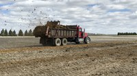 Manure is being spread at the NDSU Carrington Research Extension Center. (NDSU photo)