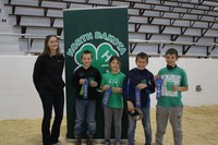 The Grand Forks County team received first place in the junior division of the state 4-H meat judging contest. Pictured, from left, are: coach Katelyn Landeis and team members Cody Draxton, Madison Todd, Bernt Draxton and Levi Todd. (NDSU photo)