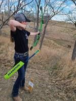 A youth takes a shot at the 4-H state archery match at the North Dakota 4-H Camp near Washburn. (NDSU photo)