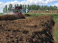 Turning compost is an essential step for maintaining proper temperature during the decomposition process. (NDSU photo)