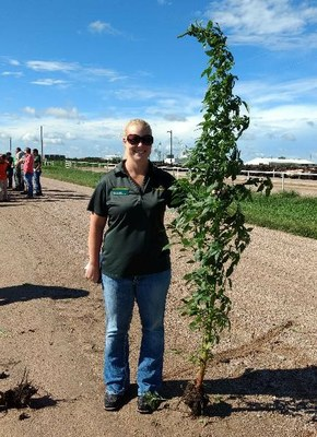 Alicia Harstad with a Palmer Amaranth Plant