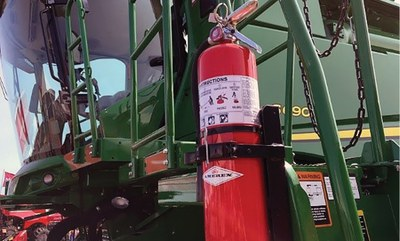 Fire extinguisher on combine