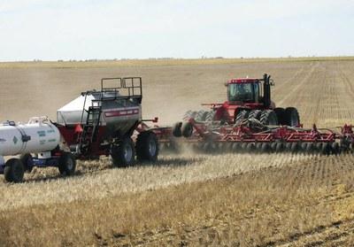 Variable-rate seeding/fertilizing