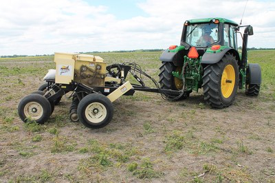 Grass drill and tractor