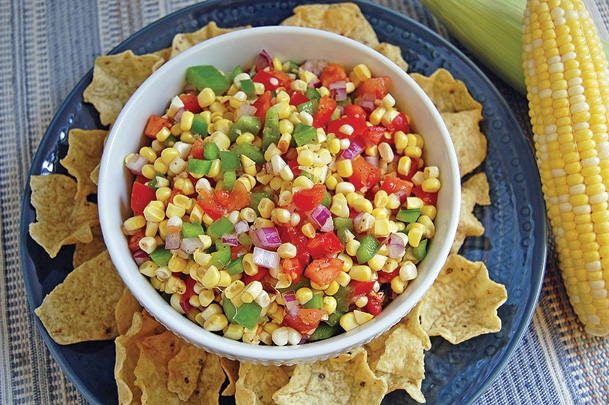 fresh corn salsa in bowl with tortilla chips