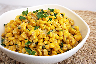 parmesan cilantro corn in a white bowl