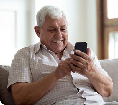 Grandpa smiling at phone