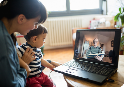 Mom and child on video call with grandma