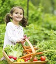 Child with basket of vegetables