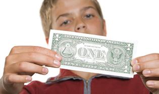 boy with dollar bill