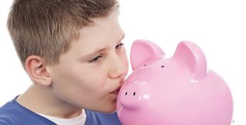 boy kissing piggy bank