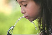 girl drinking water from fountain.jpg