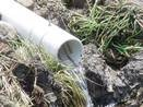 tile drain pipe with water flowing